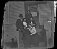 Charles Wilde, Daisy Kellum, Lucretia Kellum, H. H. West and Minnie Kellum pose on the Kellum's front porch, Los Angeles, about 1899