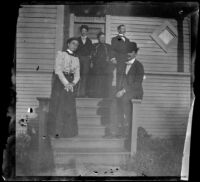 Minnie Kellum, Earl Kellum, Lucretia Kellum, H. H. West and Charles Wilde pose on the front porch of the Kellum's home, Los Angeles, about 1899