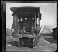 Wrecked Southern Pacific Railroad train engine sits on the tracks at River Station, Los Angeles, about 1898