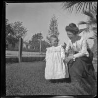 Mertie Whitaker kneels next to her nephew, Lester Shaw, Los Angeles, about 1896
