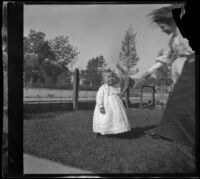 Mertie Whitaker reaches her hand to her nephew, Lester Shaw, Los Angeles, about 1896