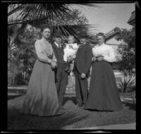 Josie, William, and Lester Shaw stand in their front yard with Abraham and Mary Whitaker, Los Angeles, about 1896