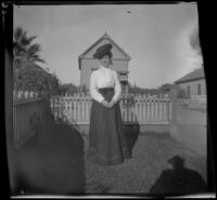Mertie West poses in her front yard, Los Angeles, about 1898