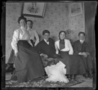 Mertie Whitaker perches on a couch with her brothers, Otto and Guy, and the Brown sisters, Los Angeles, about 1898