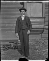 Guy West stands in front of the West's partially constructed house, Los Angeles, 1896