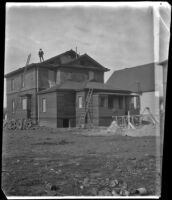 Arleigh Lemberger stands on the roof of the West's partially constructed house, Los Angeles, 1896