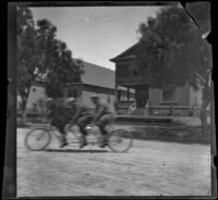 Men ride on a three-seat tandem bicycle, Los Angeles, 1897