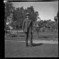 Wilson West stands on the West's front lawn, Los Angeles, 1897
