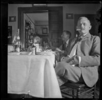 Wilhelmina West, Guy West, and H. H. Cooper sit around a table, Los Angeles, 1897