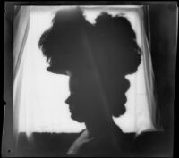 Alice Gordon poses for a silhouette portrait, Los Angeles, about 1900