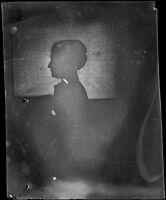 Frances Nichols poses for a silhouette portrait, facing left, Los Angeles, about 1900