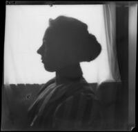Nella A. West poses for a silhouette portrait, viewed close-up, Los Angeles, about 1900