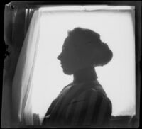 Nella A. West poses for a silhouette portrait, Los Angeles, about 1900