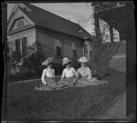 Nettie Davies, Lizzie Chandler, and Mertie Whitaker sit on the West's front lawn, Los Angeles, about 1900
