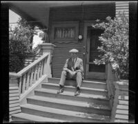 Wilson West sits on the front steps of the West's former home, Los Angeles, 1936
