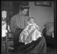 Mary West holds her baby daughter, Elizabeth, Los Angeles, about 1903