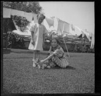 Frances and Elizabeth West in the backyard of the West's house at 165 South Harvard Boulevard, Los Angeles, about 1914