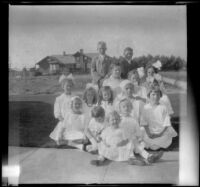 Group of children pose on the front lawn of the West's house, Los Angeles, about 1914