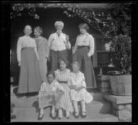 Members of the West and Cline families pose on the front porch steps of the West residence on South Harvard Boulevard, Los Angeles, about 1915