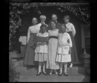 Members of the West and Cline families pose on the front porch steps of H. H. West's residence on South Harvard Boulevard, Los Angeles, about 1915