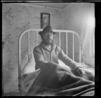 H. H. West sits up while resting in bed, Los Angeles, 1914