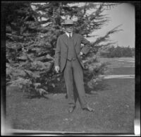 H. H. West poses on his front lawn, Los Angeles, about 1914