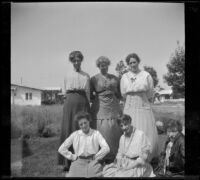 Alice Schmitz, Bessie Velzy, Kate Schmitz and three other women pose on the Velzy's front lawn, Los Angeles, about 1915