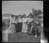 Mary A. West, Kate Schmitz, Alice Schmitz and three other women pose on the Velzy's front lawn, Los Angeles, about 1915