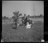 John Teel, Mary A. West, Hattie Cline and baby Ambrose Cline sit in a field at John Teel's ranch, Los Angeles, [about 1915]