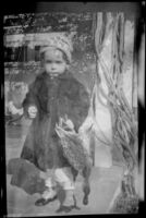H. H. West Jr. holds birds, Los Angeles, about 1919