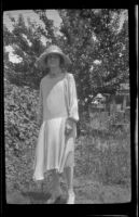 Mertie West stands in a backyard, Los Angeles, about 1925
