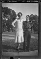 Mertie West stands on the West's front lawn with her arm around H. H. West Jr., Los Angeles, about 1933