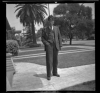 H. H. West stands in front of his house wearing his Shriners fez, Los Angeles, 1938