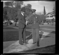 H. H. West Jr., in his army uniform, shakes hands with H. H. West, Los Angeles, 1940