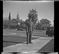 Gilbert Cecil West poses on H. H. West's front walk on South Griffin Avenue, Los Angeles, 1941