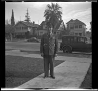 Gilbert Cecil West poses in uniform on H. H. West's front walk, Los Angeles, 1941