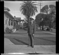 Gilbert Cecil West stands in uniform on H. H. West's front walk, Los Angeles, 1941