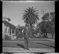 Gilbert Cecil West poses in uniform while standing on H. H. West's front walk, Los Angeles, 1941