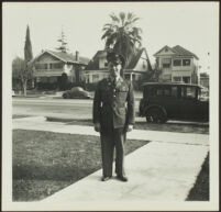 Gilbert Cecil West poses in uniform on H. H. West's front walk [print, recto], Los Angeles, 1941