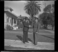 H. H. West shakes Gilbert Cecil West's hand while both stand on H. H. West's front walk, Los Angeles, 1941