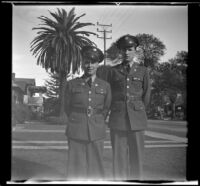 Close-up of Gilbert Cecil West and William Roscoe Wright standing in uniform on H. H. West's front walk, Los Angeles, 1941