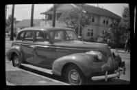 Buick car parked at the curb in front of H. H. West's house, Los Angeles, 1942