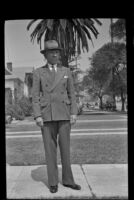 H. H. West poses with a palm tree in the background, Los Angeles, 1942
