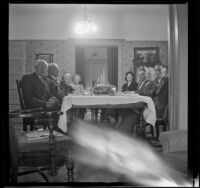 H. H. West and Mertie Whitaker West's family sit at the Thanksgiving table, Los Angeles, 1942
