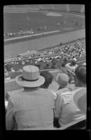 Spectators watch the preparations for a track event at the Olympic Games, Los Angeles, 1932