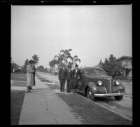 Mertie, Nella, Wilson, Richard, and Eleanor West stand on the sidewalk by Wilson's Studebaker, Los Angeles, 1937