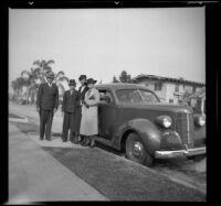 Wilson, Richard, Eleanor, and Mertie West stand by Wilson's Studebaker, Los Angeles, 1937