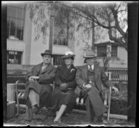 Fred and Mary Lemberger sit on a bench in front of Union Station with H. H. West, Los Angeles, 1940