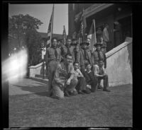 Richard Siemsen poses with Boy Scout Troop no. 76 in front of Asbury Methodist Church, Los Angeles, 1943
