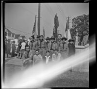 Richard Siemsen poses with Boy Scout Troop no. 76 outside Asbury Methodist Church, Los Angeles, 1943